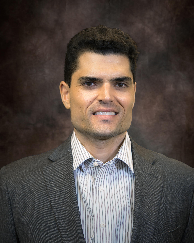 John Fernandez, Ph.D.